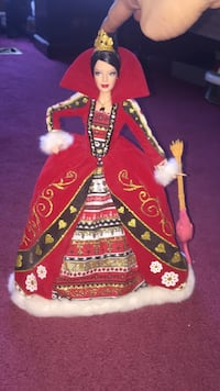 Barbie doll in red and multicolored floral long-sleeved gown Mississauga, L5N 7E7