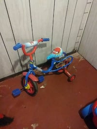 toddler's blue and red bike with training wheels