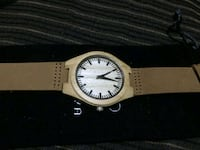 round silver analog watch with brown leather strap Cary
