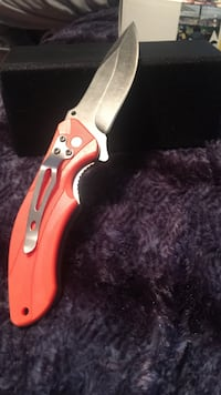 stainless steel folding knife with red handle Penn, 17331