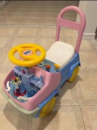 toddler's pink and blue ride-on toy