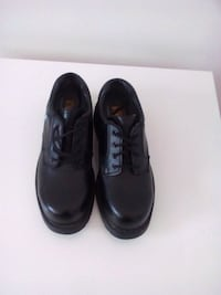 pair of black leather shoes .BREND .NEW .Size 9 Winnipeg, R2M 3B7