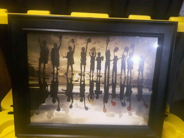 brown wooden framed painting of people