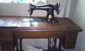 black and brown Singer sewing machine,300 OBO