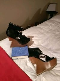 pair of women's black-and-brown leather gravity heels