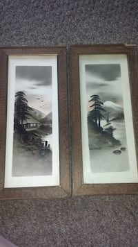 two tree paintings with brown frames