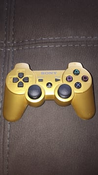 Yellow sony ps3 game controller New Westminster, V3M 6G2