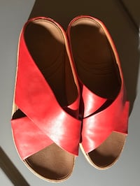 pair of red leather open-toe sandals