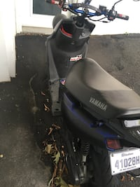 black and purple motor scooter Longueuil, J4K 5A8