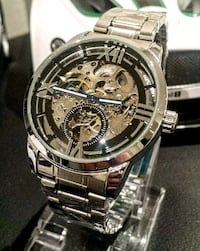 Stainless intricate skeleton dial automatic watch