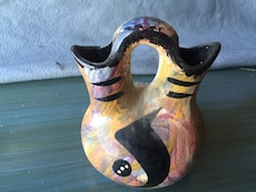 yellow and black ceramic vase