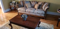 brown wooden frame with brown padded sofa Vaughan
