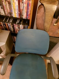 Blue and black office rolling chair
