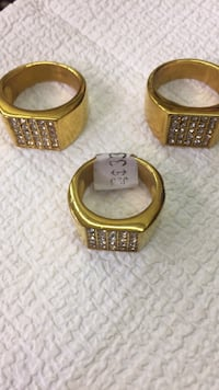 three gold-colored rings with clear gemstones Stafford, 77477