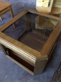 brown wooden framed glass top coffee table Las Vegas, 89108