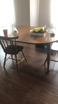 round brown wooden table with four chairs dining set Dundas, L9H 2S1