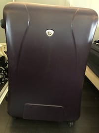 Large purple hardcover suitcase