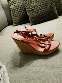 pair of brown leather wedge sandals Calgary, T3M 2C6
