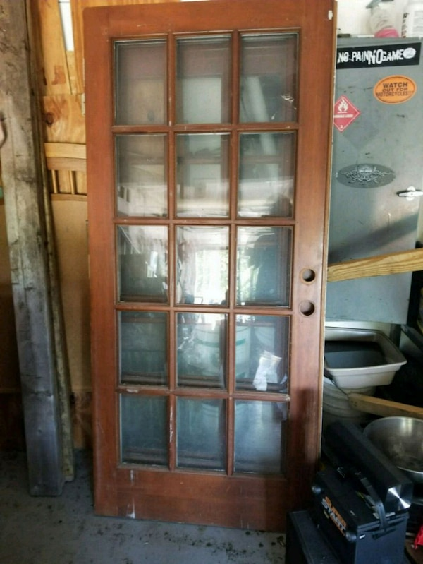 brown wooden framed glass panel door