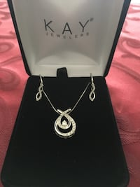 10k white gold and diamond pendant necklace. from kay jewelers. paid $679. just cleaned and checked at kay jewelers. cash only 10k white gold and diamond earrings. from kay jewelers. paid $280. both just cleaned and checked at kay jewelers. cash only