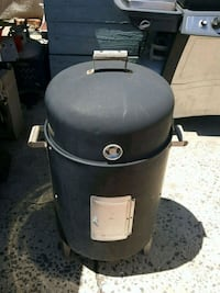 black and gray charcoal smoker grill with heat thermostat