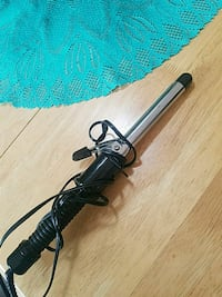 black and silver electric hair curler 445 mi