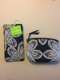 Two quilted b-and-white vera bradley wallets
