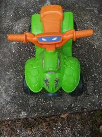 green and orange TMNT theme ride on toy
