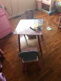 white and pink wooden chair