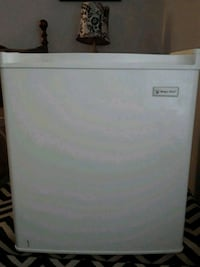 white Magic Chef compact refrigerator 1156 mi