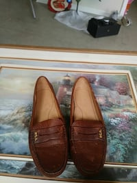 pair of brown leather penny loafers