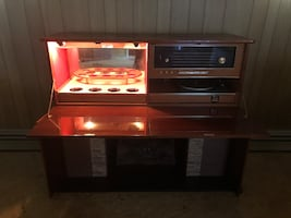 Record player with faux fire place