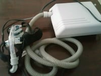 white and gray canister vacuum cleaner