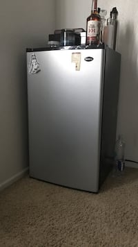 gray and black Haier compact refrigerator