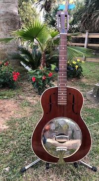 Dobro guitar (left handed) with picks and stand. Dickinson, 77539