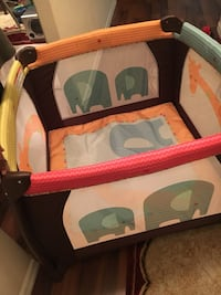 baby's red and black travel cot 827 mi