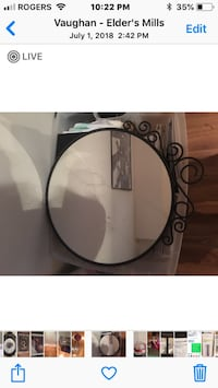 Black wrought iron mirror.  Vaughan, L4H 1N7