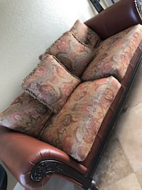 brown floral 2-seat couch and throw pillows Pembroke Pines, 33029