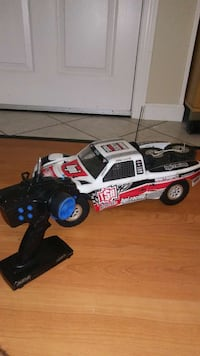 white and red RC toy race car
