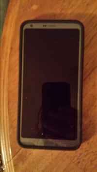 silver LG Android smartphone and blakc case 3716 km