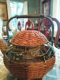 Large metal and wicker tepot decoration