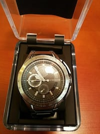round gray Armani Exchange chronograph watch in case