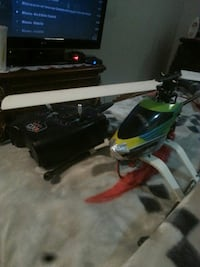 two black and green Rc helicopters