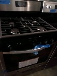 Whirlpool stainless steel stove gas 5 burners and  Baltimore, 21223