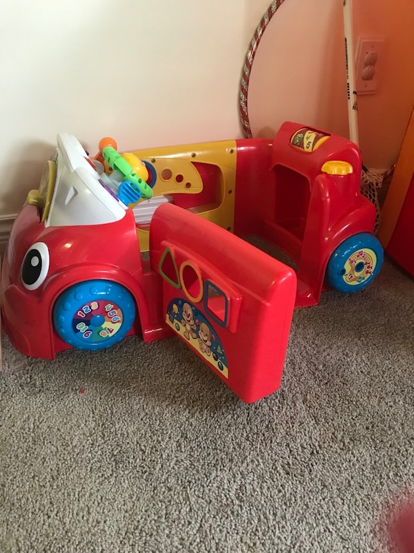 toddler's red and multicolored ride-on toy