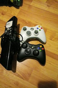 black Xbox 360 game console with two controllers Martinsburg, 25401