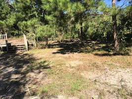 Almost 1 acre , long private driveway. Walk to the beach ! Waveland Mississippi. Possibly owner financing