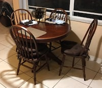 round brown wooden table with four chairs dining set 897 mi