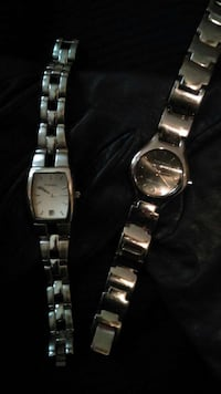 two stainless steel analog watches with link bracelets