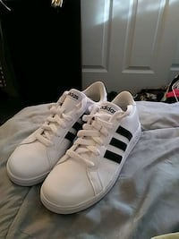 pair of white Adidas Superstar Rochester, 03839